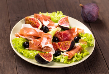 Prosciutto with figs, olives and arugula