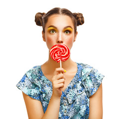 Fashion makeup. Beauty Girl Portrait holding Colorful lollipop