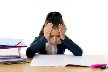hispanic sweet little girl upset in stress studying homework
