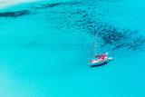 Sailboat anchored in Porto Giunco bay. Sardinia Island. Italy.