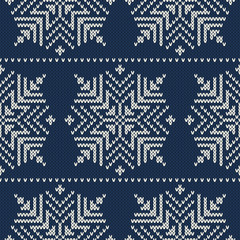Christmas knitted ornamental pattern with snowflakes