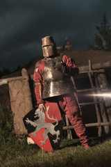 Medieval knight in the armor with the sword