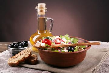 Bowl of Greek salad served with olive oil