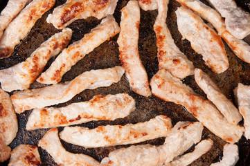 Meat Strips Fried In A Pan
