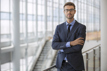 Handsome confident businessman with glasses portrait