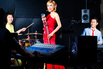 Asian professional band in recording studio mixing
