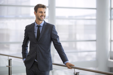 Friendly and smiling businessman looking at the horizon