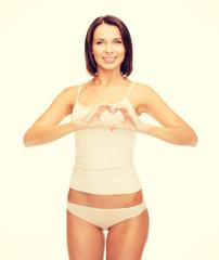woman forming heart shape