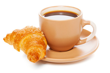 Cup of coffee with a croissant