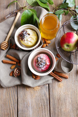 Baked apples in bowls on table close up