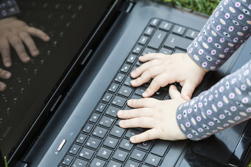 Child's hands on the laptop