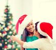 hugging mother and daughter in santa helper hats