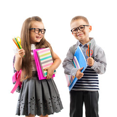 Two smiling school kids with colorful stationery