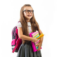 Schoolgirl with pink satchel  in glasses holding book