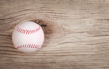 Baseball. Ball on wood background with copy space.