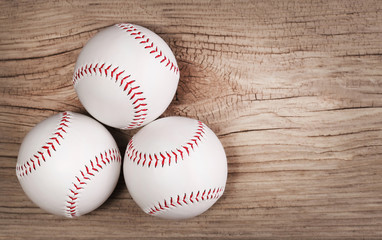 Baseball. Balls on wood background with copy space.