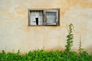 old wall with old and broken wooden windows