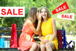 Concept of discount. Two beautiful young woman with shopping