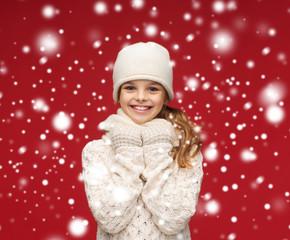 smiling girl in white hat, muffler and gloves