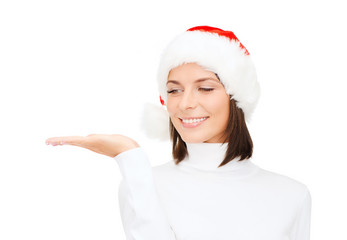woman in santa helper hat with something on palm