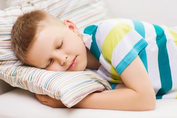 little boy sleeping at home