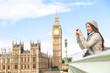 Travel tourist in london sightseeing taking photos