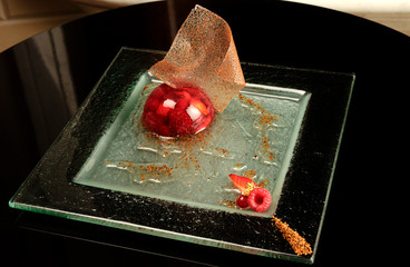 Berry dessert jelly on a glass plate