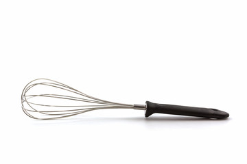Metal whisk for whipping eggs on white background.