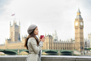 London woman drinking coffee by Westminster Bridge