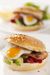sandwich with avocado, egg, pepper and bacon