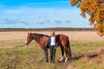beautiful woman walking with horse