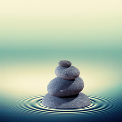 Wet pebble in the water , alternative medicine concept