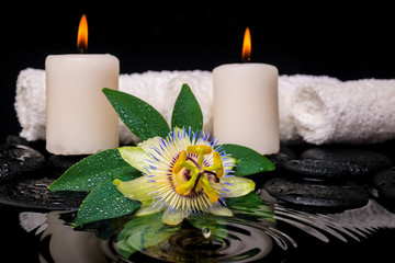 spa concept of passiflora flower, green leaf with drop, towels a
