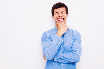 Laughing guy with hand on his chin