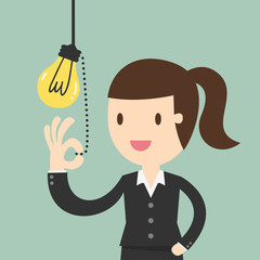 Business woman pulling light switch, Idea concept