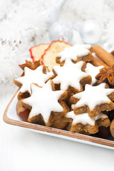star cookies, nuts and spices for Christmas in a bowl