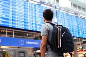 Guy near airline schedule