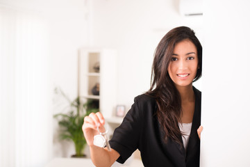 young business woman real estate agent giving keys new house