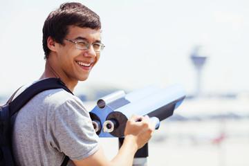 Guy with tourist binoculars