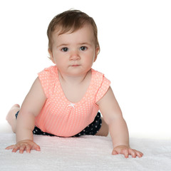 Cute baby girl on the carpet