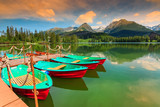 Colorful boats,pier and mountain lake,Strbske Pleso,Slovakia