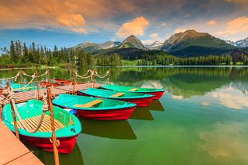 Colorful boats,pier and mountain lake,Strbske Pleso,Slovakia