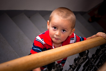 Scared child on the stairs