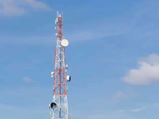 Telecommunications tower in a day of clear blue sky.