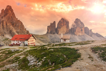 Colorful sky,chapel and shelter,Dolomites,Italy