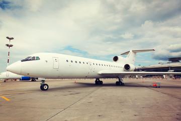 white plane on the platform