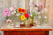 canvas print picture - nice flowers in the bottles