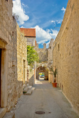 Old stone narrow street of Hvar