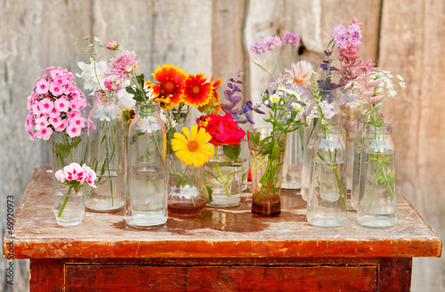 canvas print picture nice flowers in the bottles