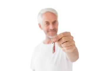Happy mature man holding new house key